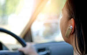 Using bluetooth headset on a call while driving.