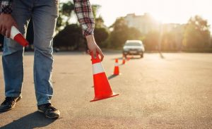Driving instructor setting cones.