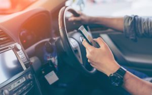 Using smartphone while driving.